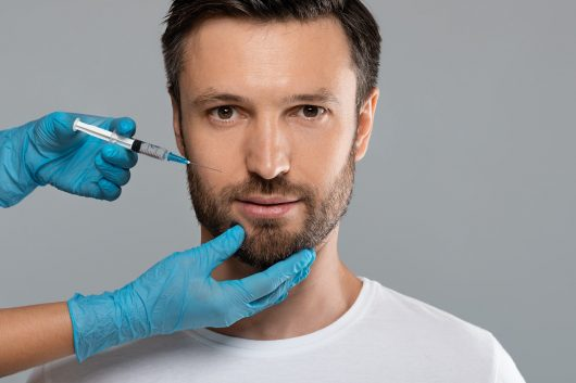 Closeup of middle-aged man getting anti-aging procedure