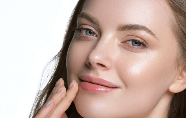 Warm skin woman cosmetic beauty face close up