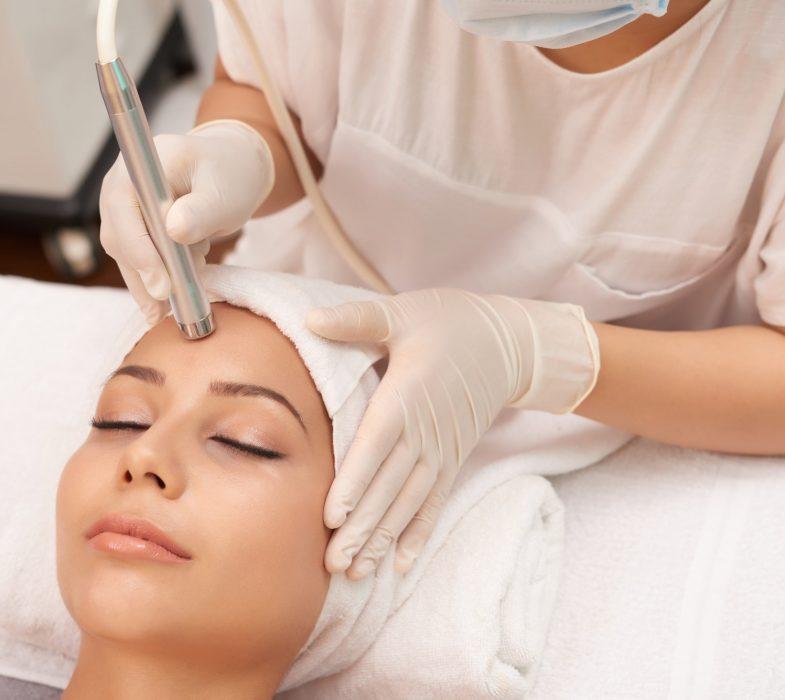 Woman getting a laser skin treatment