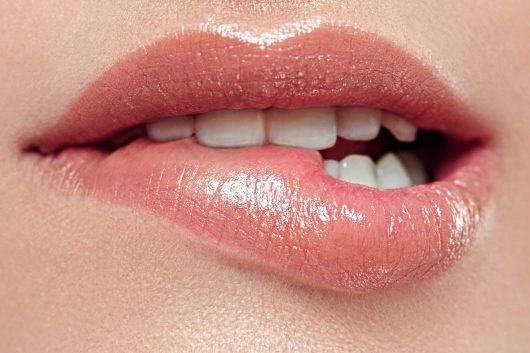 Woman lips mouth biting lip